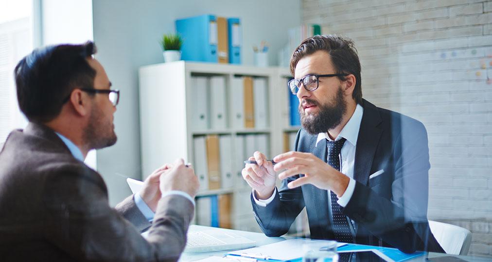 men talking in the office