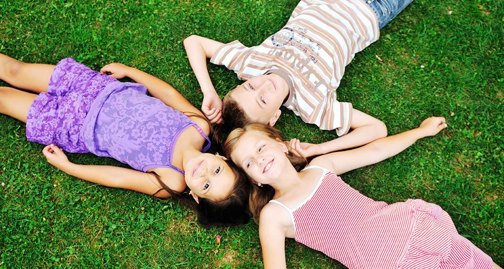3 happy kids on grass