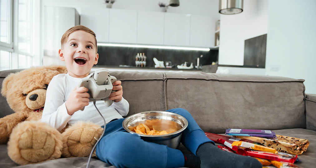 boy playing games by console