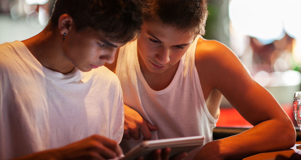 boys using a tablet for fun