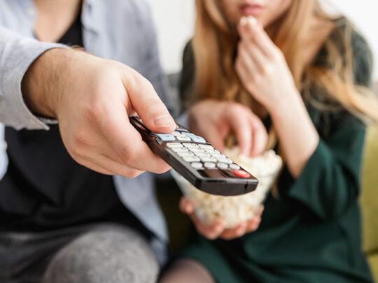 couple using tv remote control