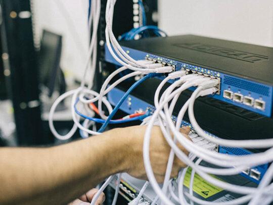 engineer working server rack