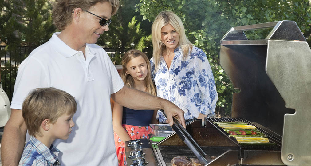 family around the grill