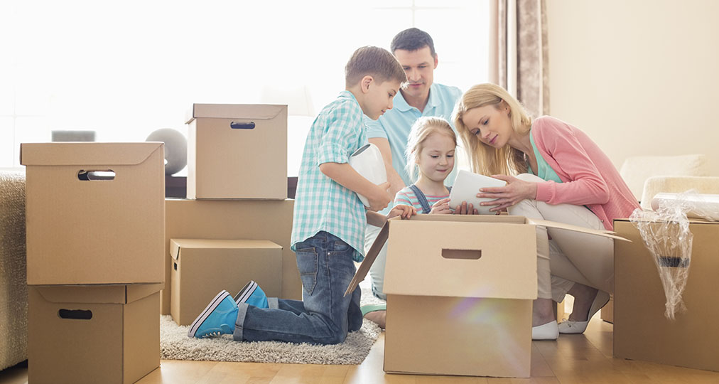 family preparing moving boxes