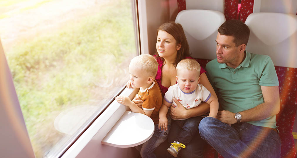 family with children in train