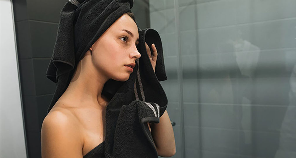 girl with black towel