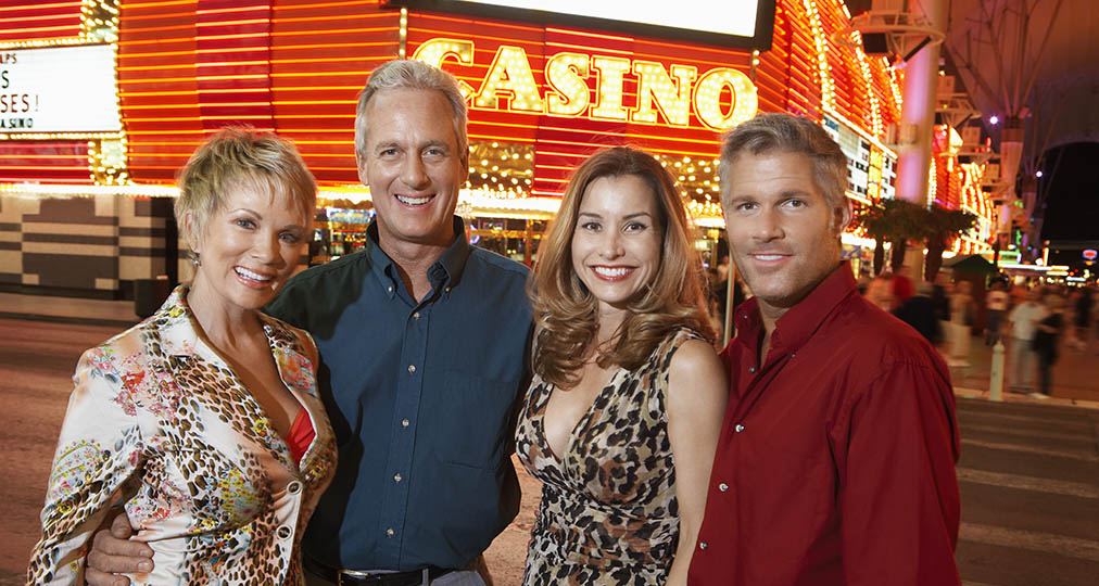 happy couples in front of casino
