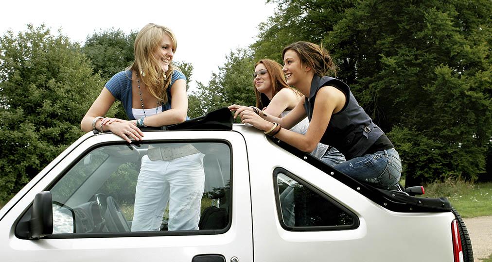 happy girls in white car