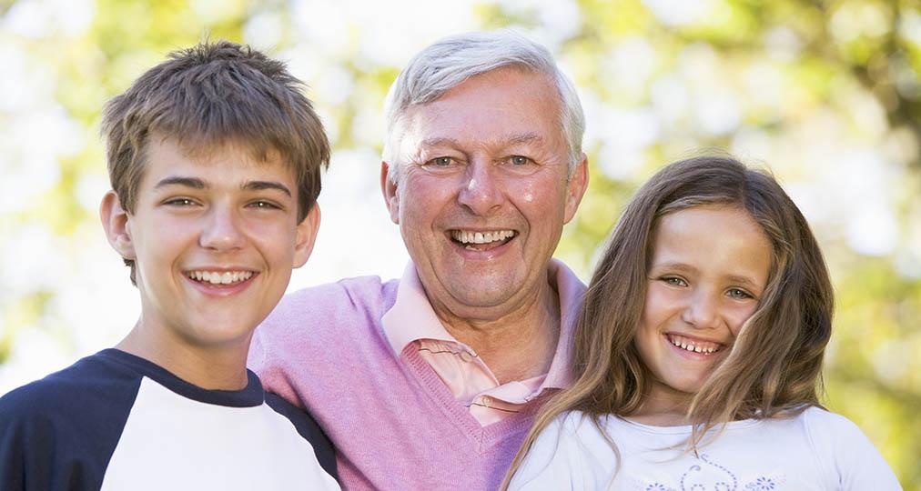 happy grandpa with grandchildren