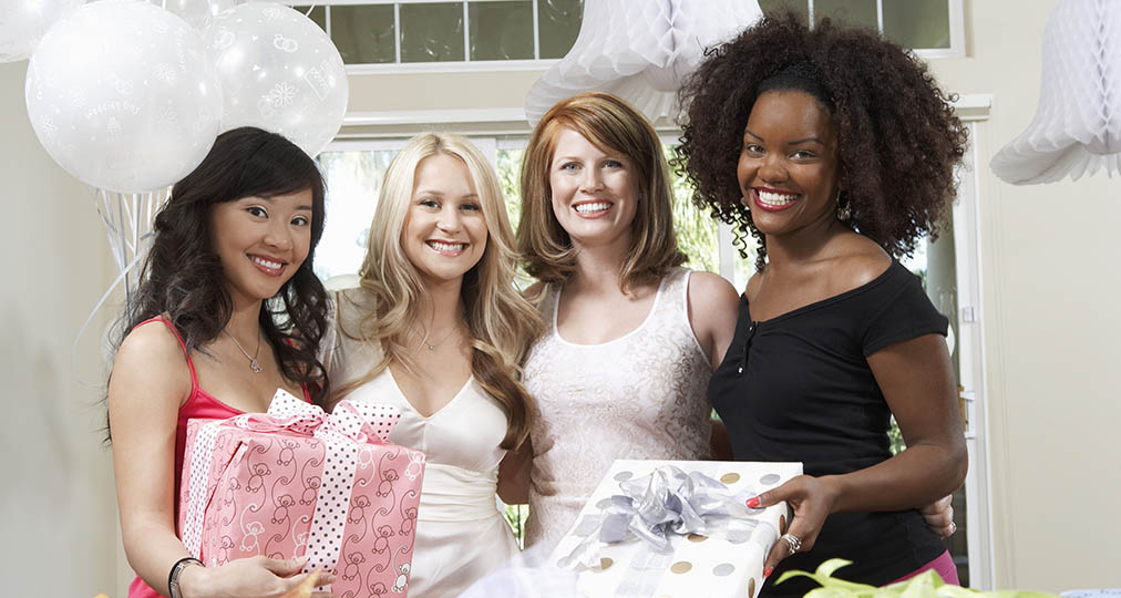 happy women with gift boxes