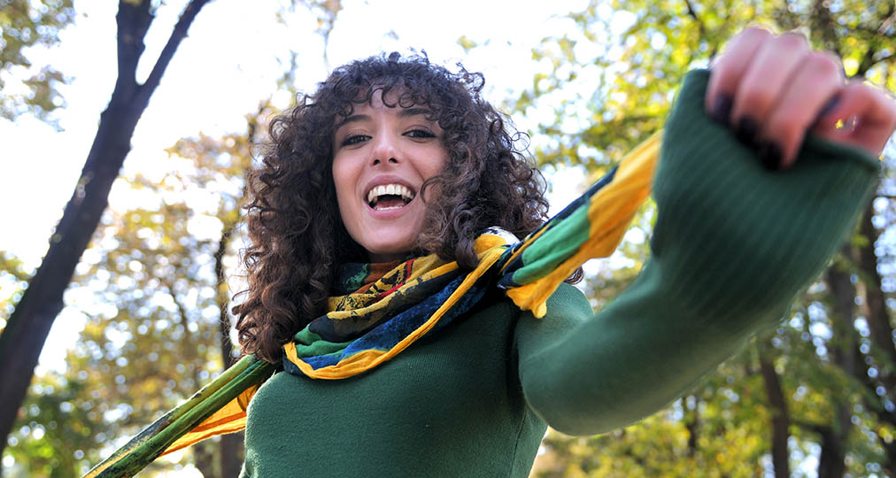 happy young woman with green sweater
