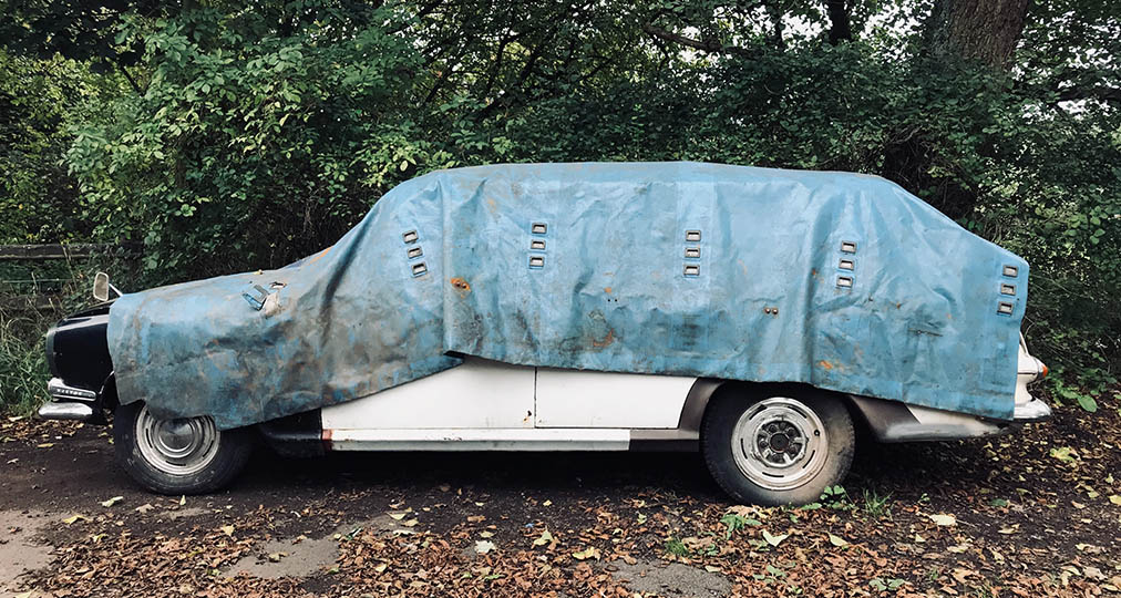 junk car covered