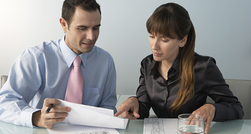 man and woman studying insurance policy