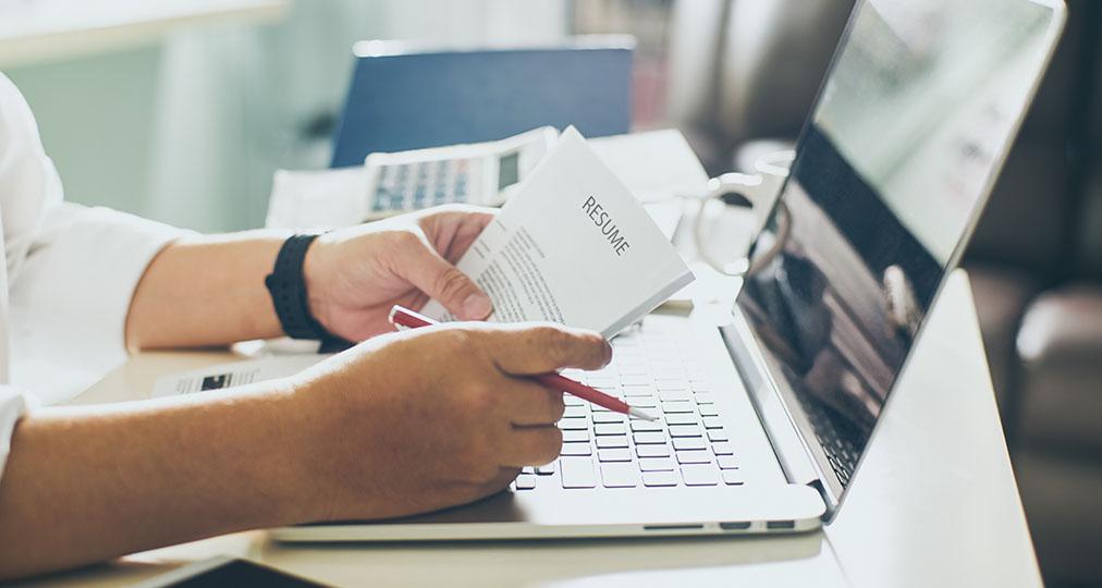 man checking resume