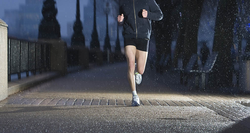 man jogging in the rain