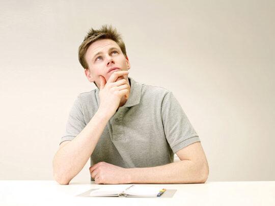man looking up thinking
