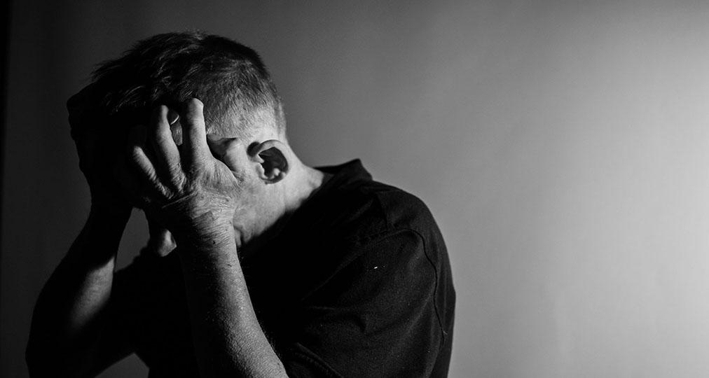 man suffering terrible headache