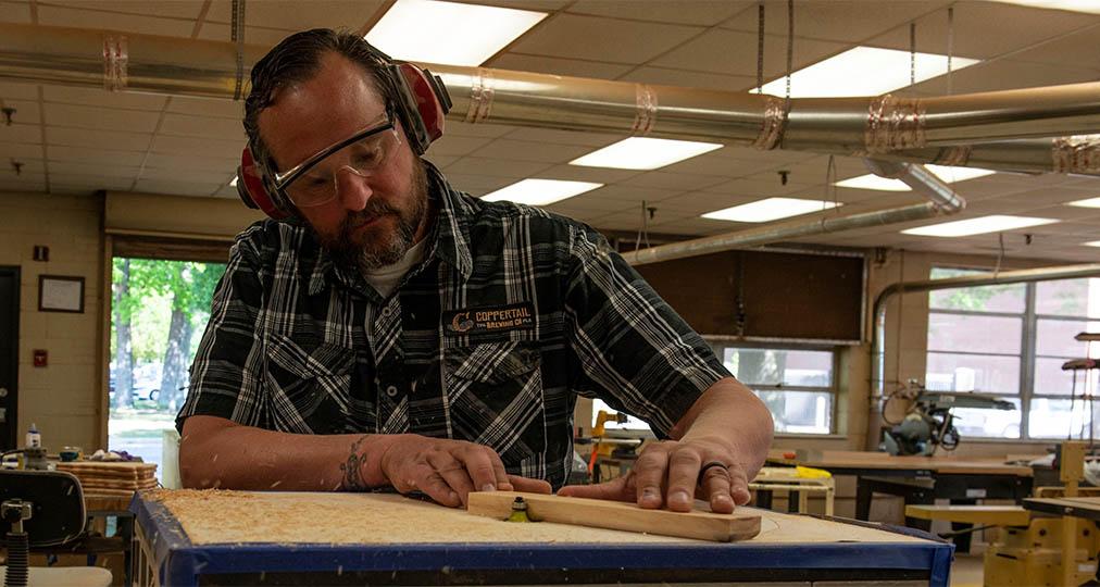 man woodworking shop