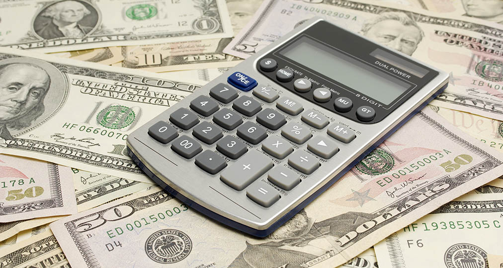 money dollars and mini calculator