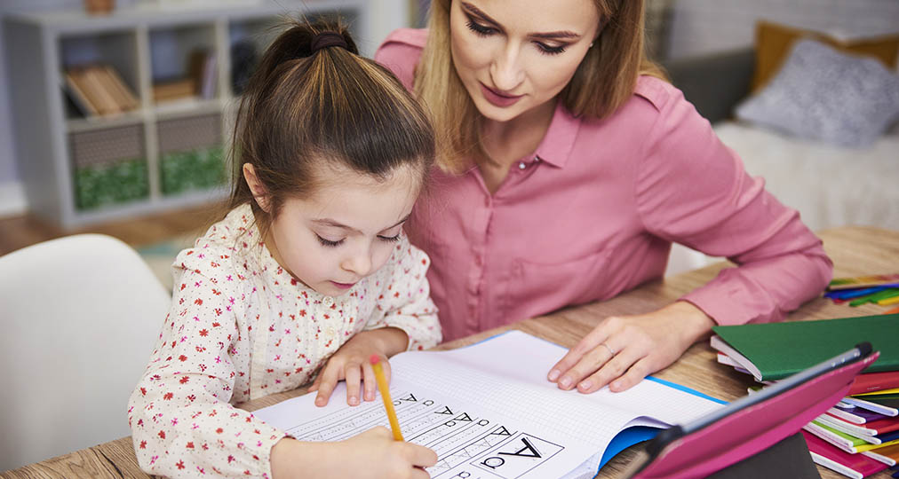 mother and daughter learning to write