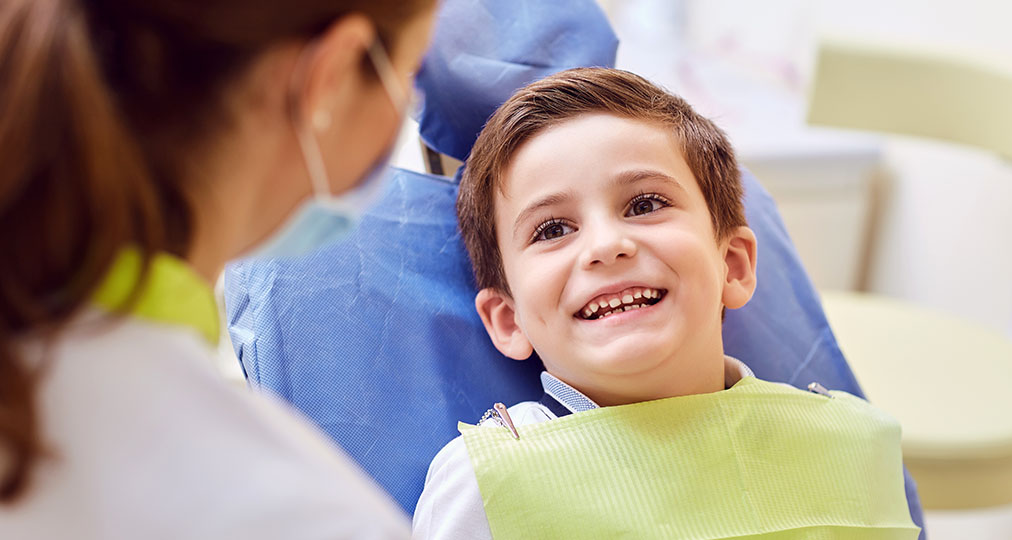 smiling kid at dentist
