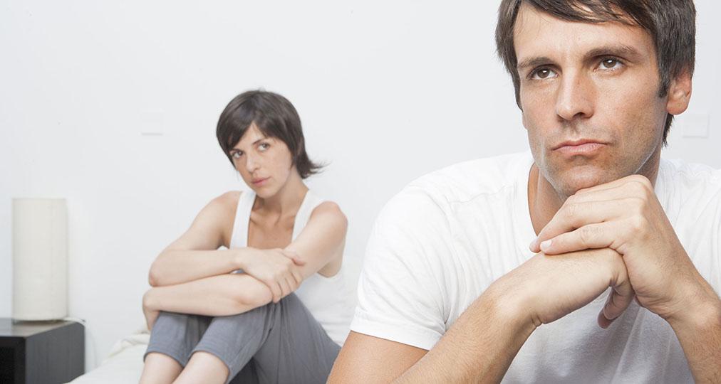 upset couple in bedroom