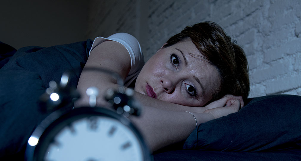 woman awake in the middle of the night