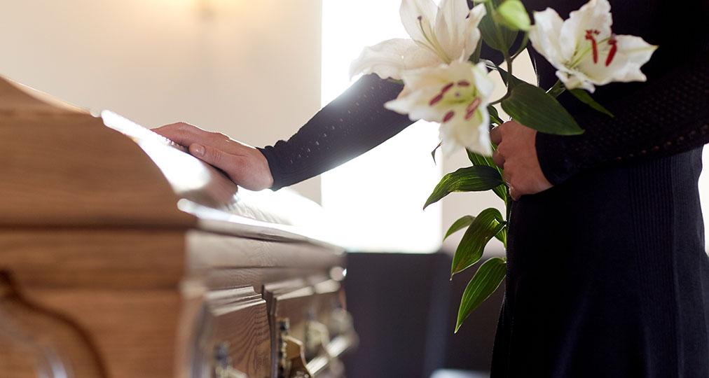 woman near casket