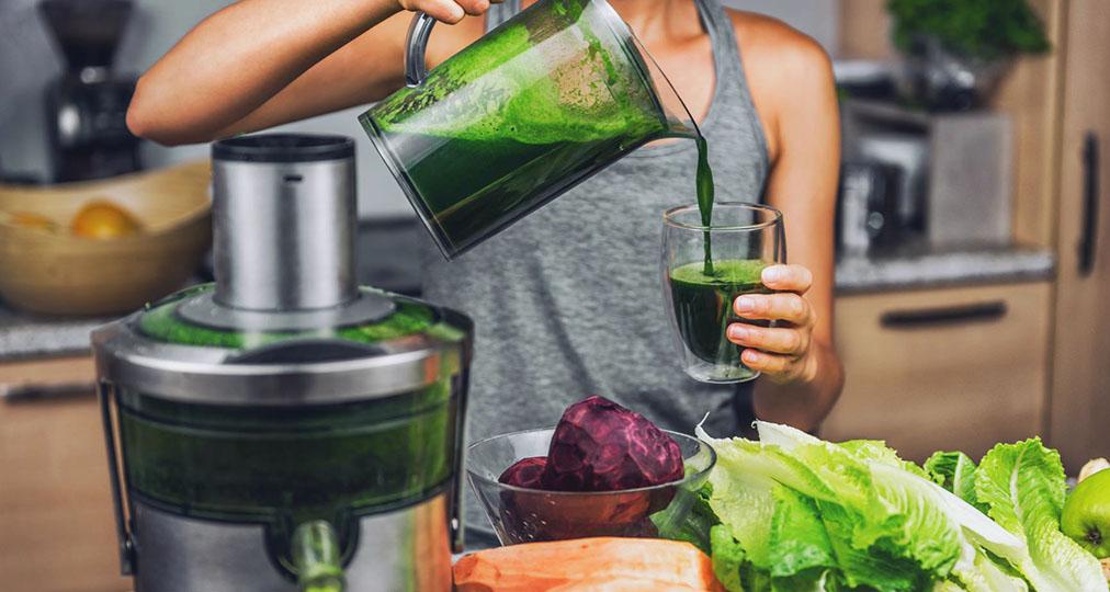 woman preparing healthy drink