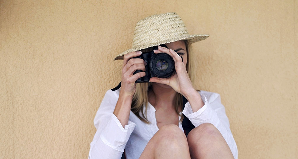 woman taking a photo with her camera
