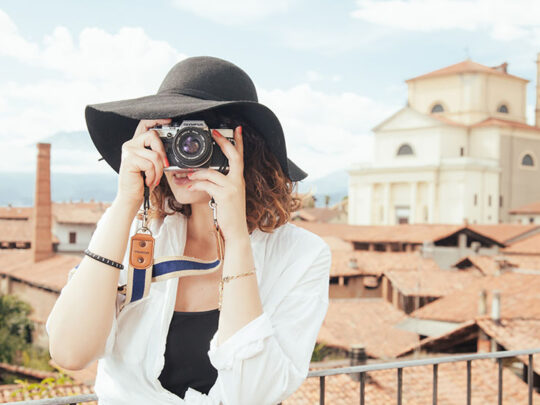 woman taking photo in italian city