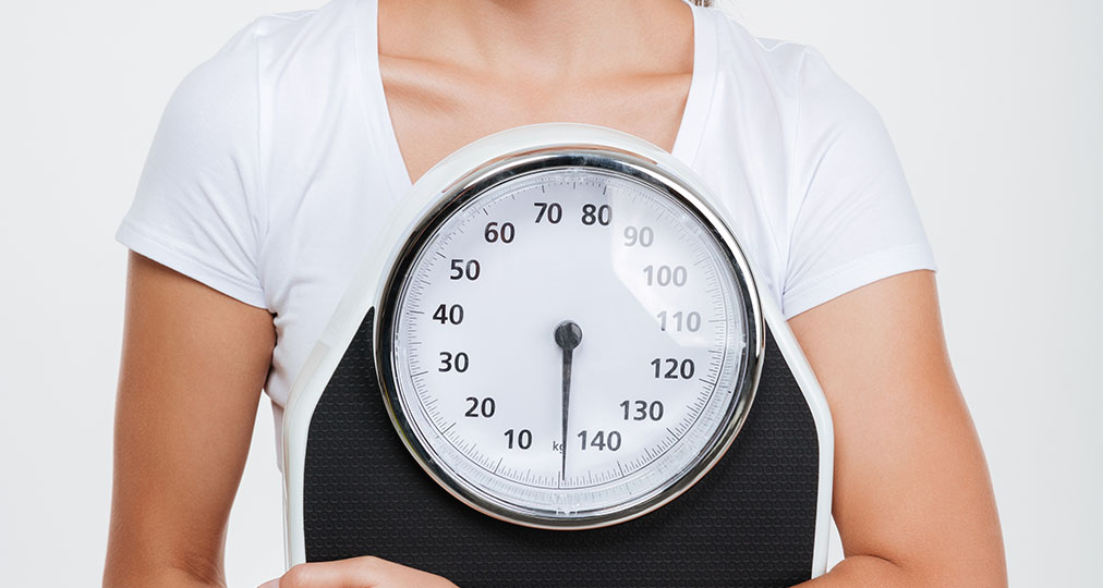 woman with weight scale