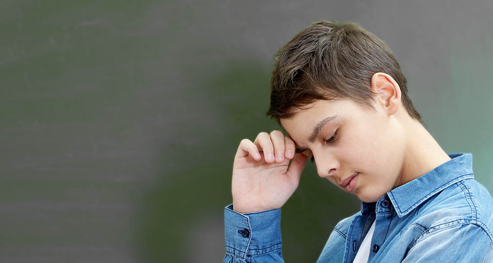 young boy thinking