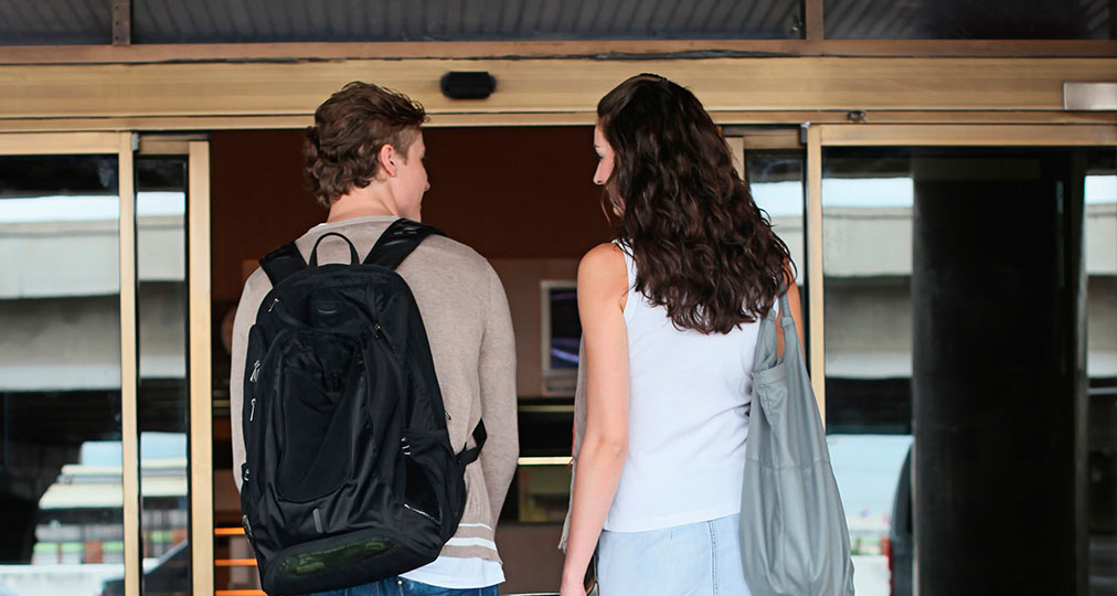 young couple entering the airport