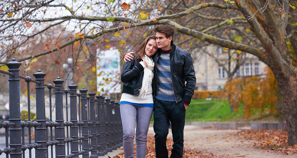 young couple walking during fall