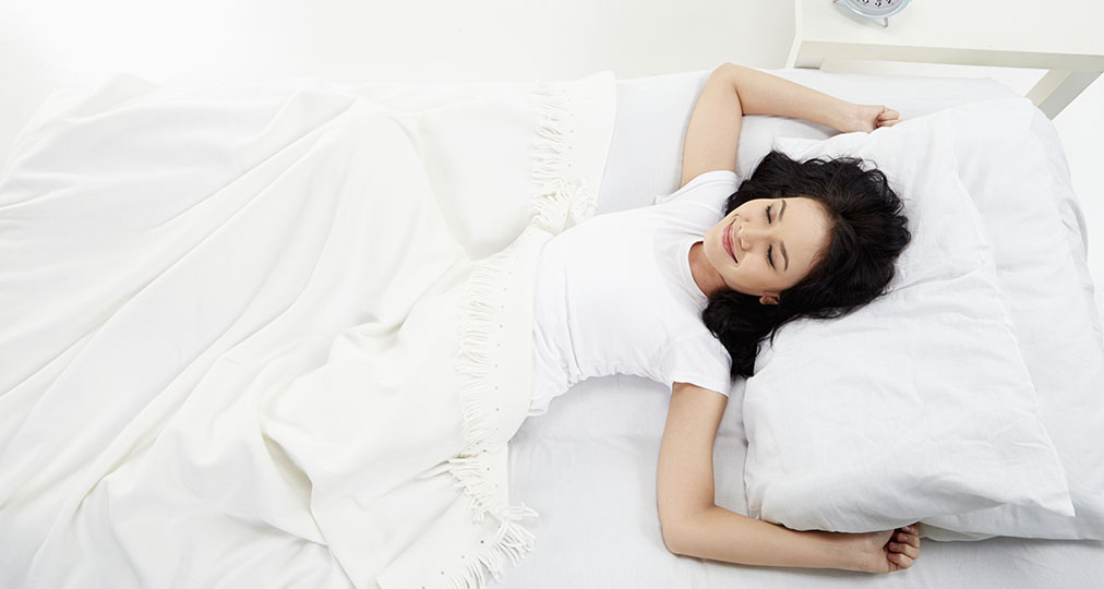 young woman happy after good sleep