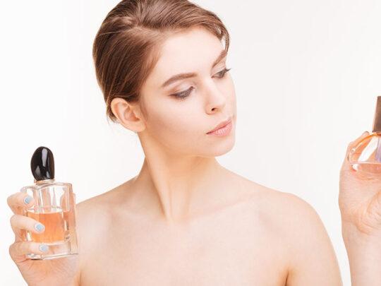 young woman testing perfumes